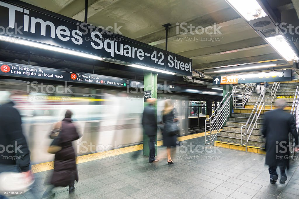 Commuters at Times Square Subway Station in New York City stock photo