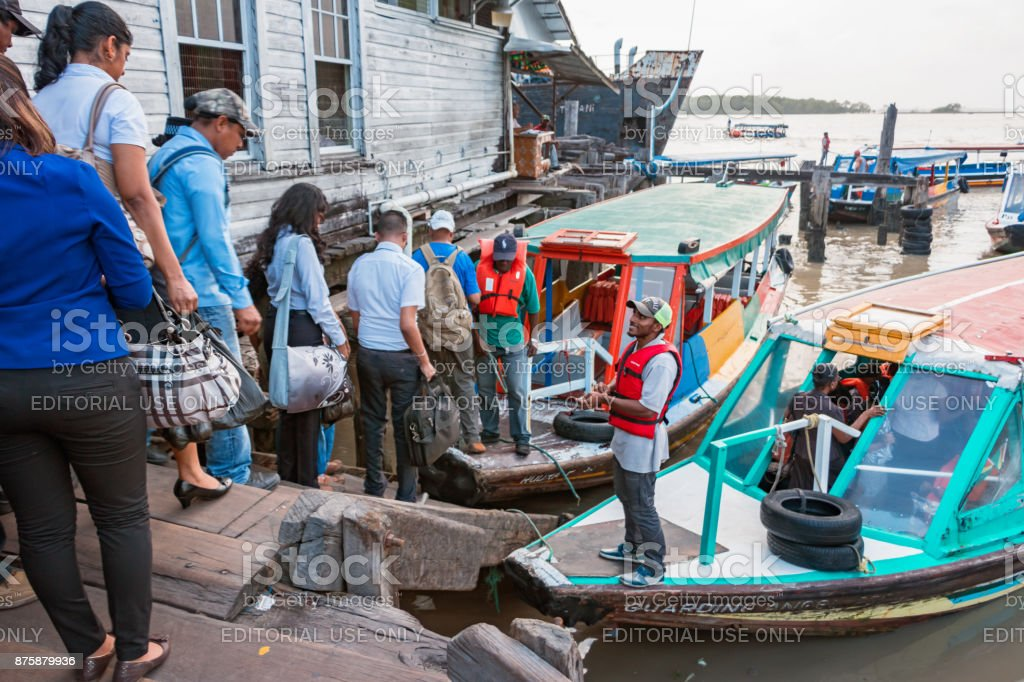 Commuters board passenger boats in Georgetown Guyana stock photo