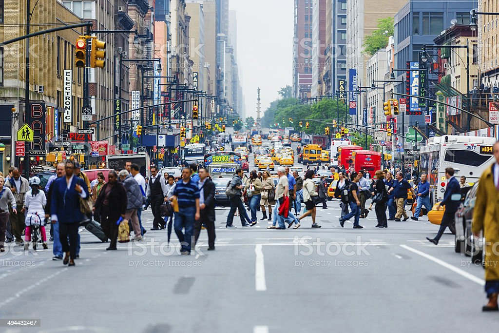 Commuters crossing 8th Avenue in New York City, USA stock photo