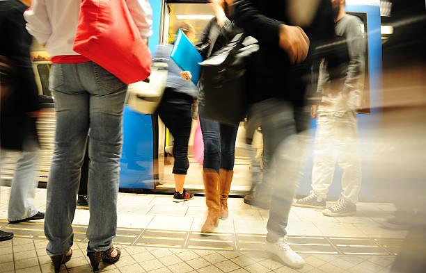 commuters entering and exiting subway train - tunnel trafik sverige bildbanksfoton och bilder