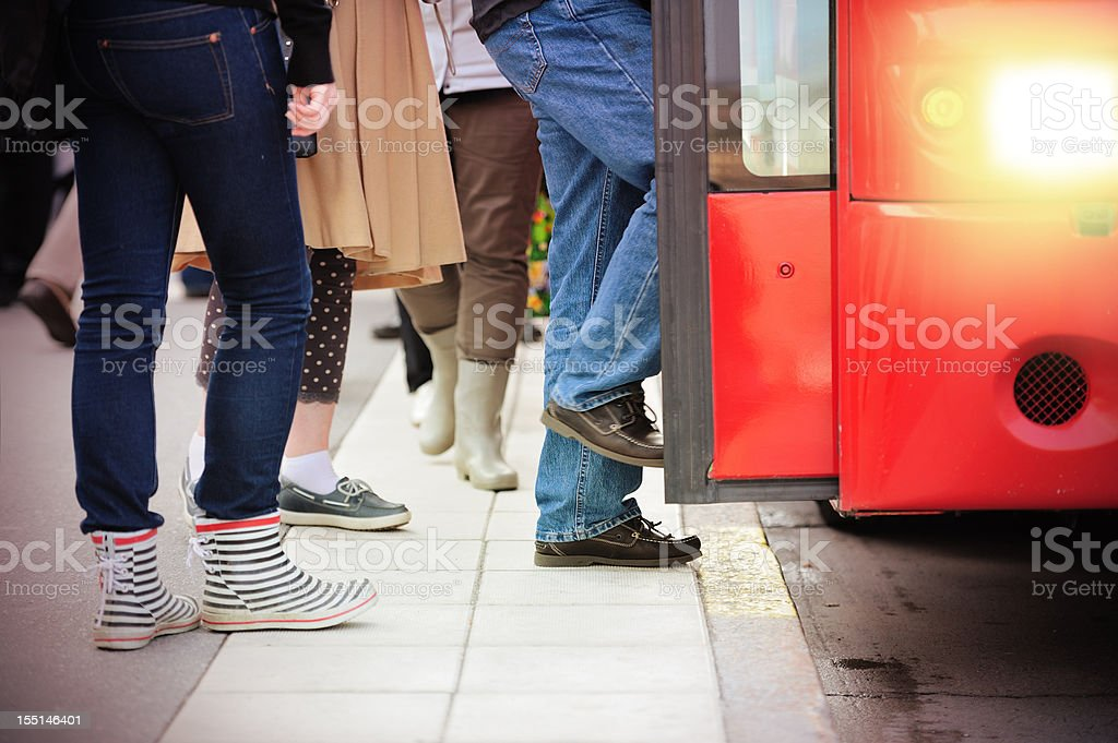 Commuters entering red bus stock photo