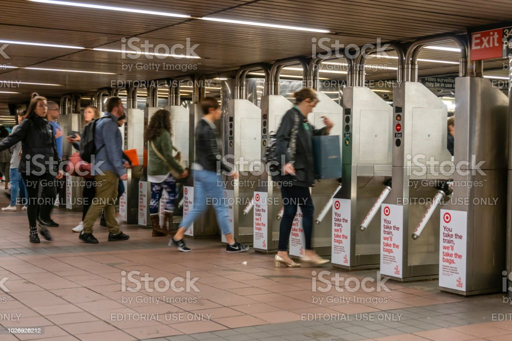 Commuters going through the turnstiles in a subway station in New York City stock photo