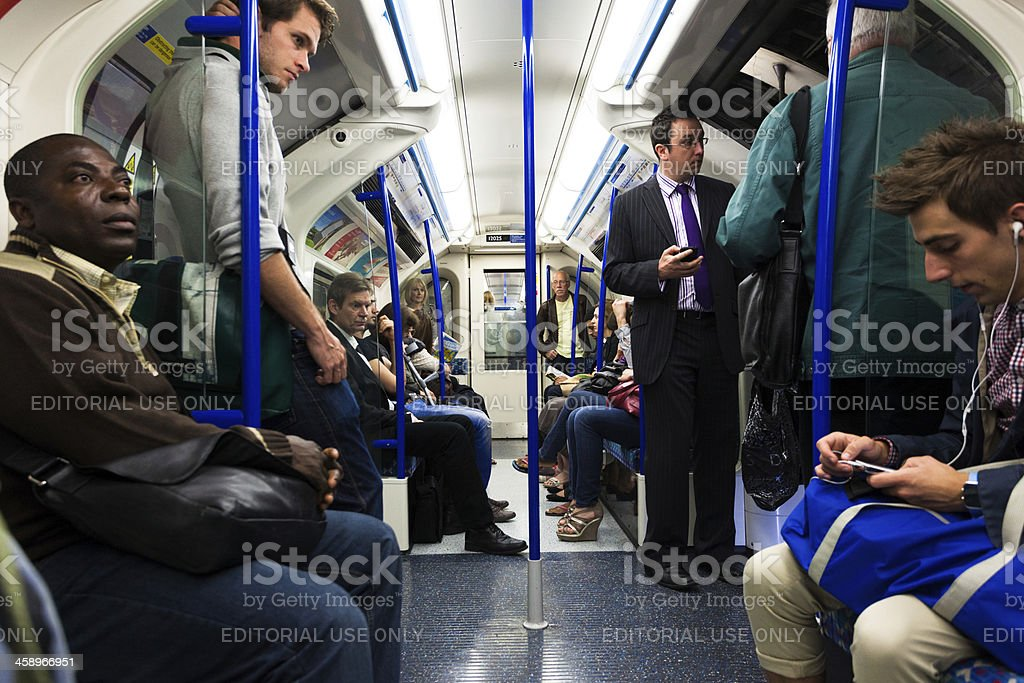 Commuters in London Underground, Piccadilly Line royalty-free stock photo