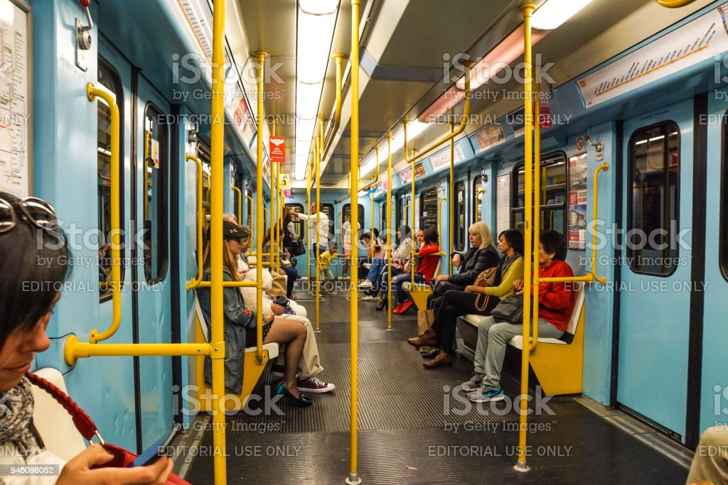 MILAN, ITALY - FEBRUARY 25: Commuters in subway wagon on February 25, 2018 in Milan, Italy. Milan underground is spread over three lines for a total of about 76 km long and 84 stations in operation. - foto stock