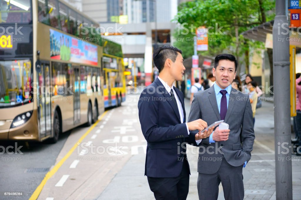 Commuters in suit having a discussion in Hong Kong royalty-free stock photo
