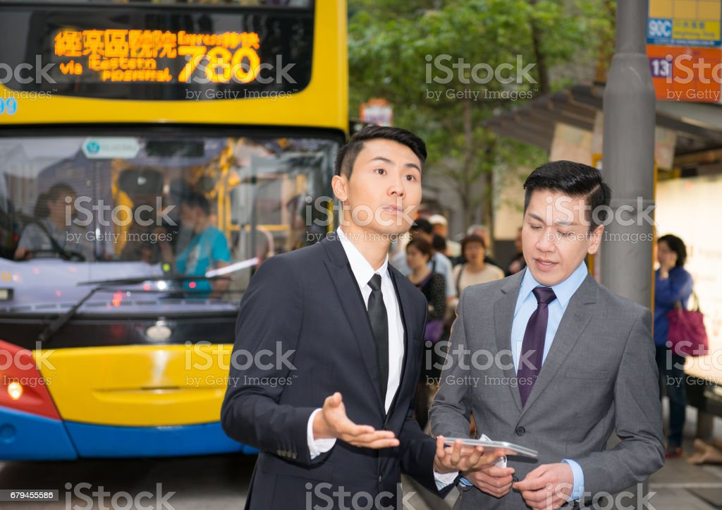 Commuters in suit trying to find their way in Hong Kong royalty-free stock photo