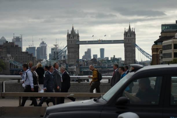 Commuters, London Bridge and Tower Bridge stock photo