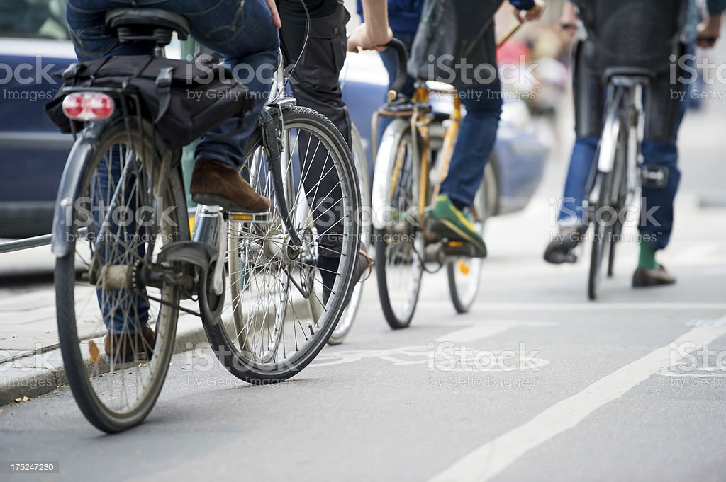Commuters on bicycle in the city. stock photo