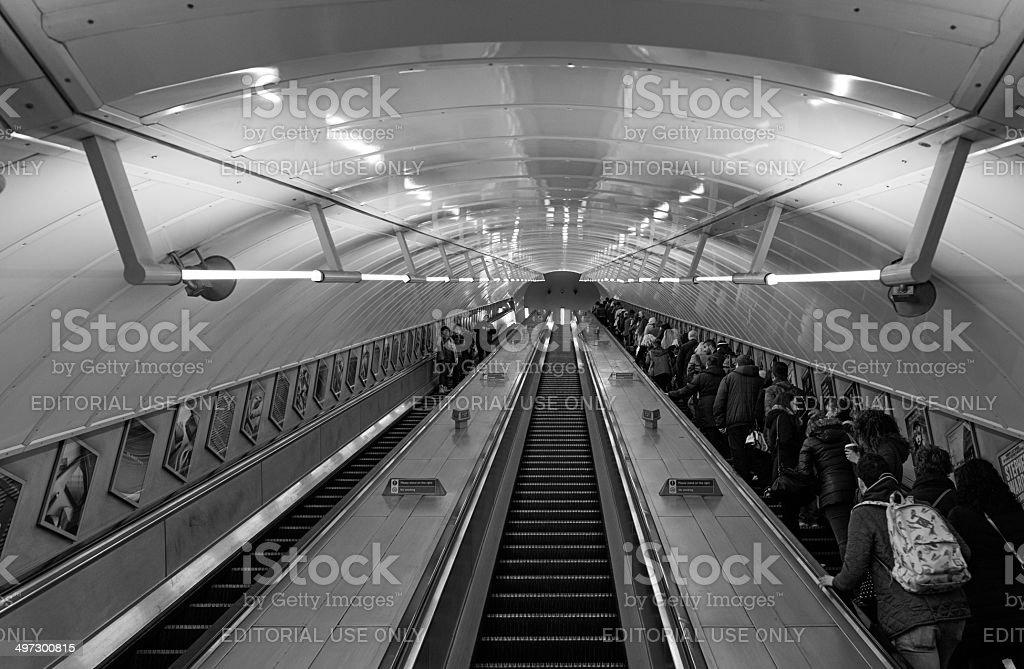 Commuters on escalator in London's underground stock photo