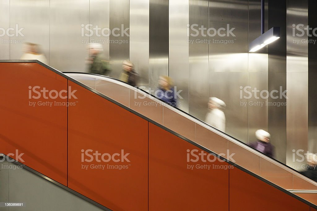 commuters on escalator motion blurred copy space royalty-free stock photo