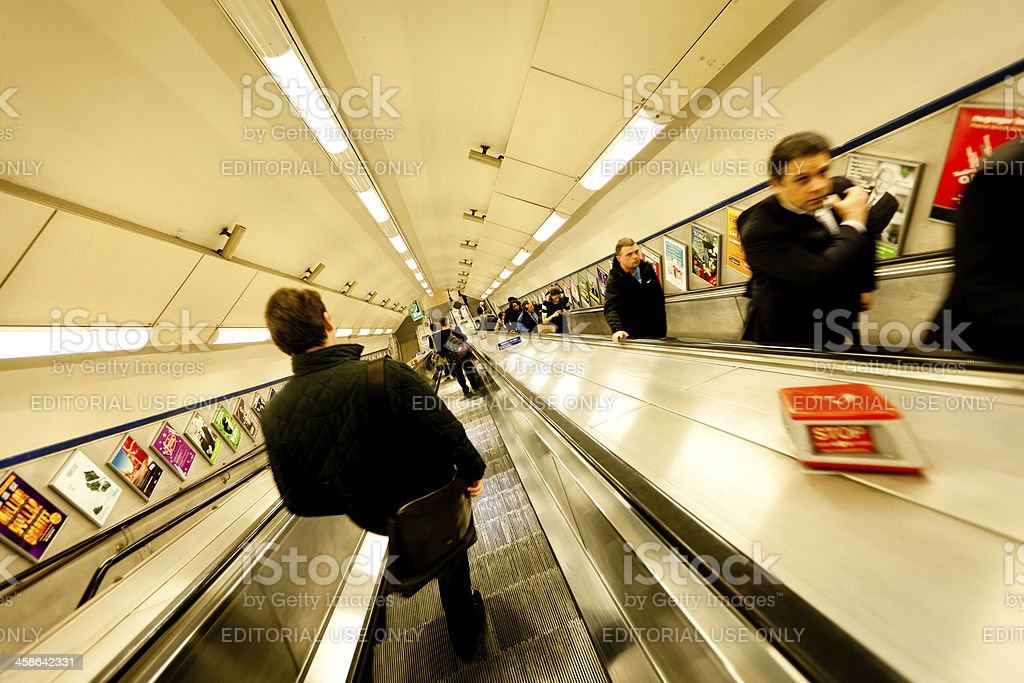 Commuters on escalator royalty-free stock photo