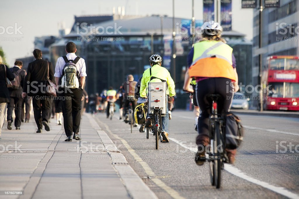 Commuters on foot and cycling stock photo