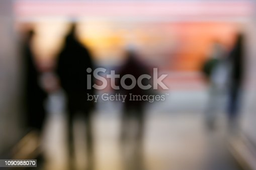 People on the subway station, blurred. Modern urban lifestyle, rush hour, stressful life, transition and passage abstract and concept.