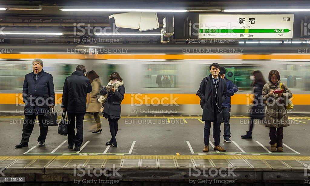 Commuters waiting at Shinjuku Station stock photo
