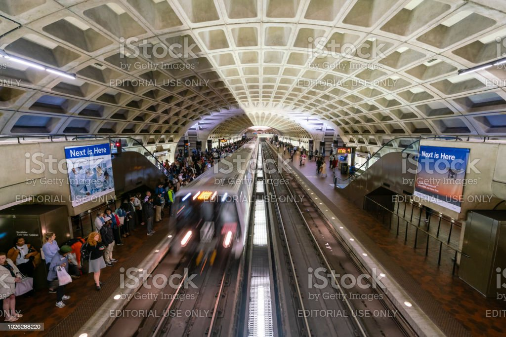 Commuters waiting for train at a Metro station in Washington DC Washington DC, USA - May 18, 2018: Commuters waiting for train at a Metro station in Washington DC Architecture Stock Photo