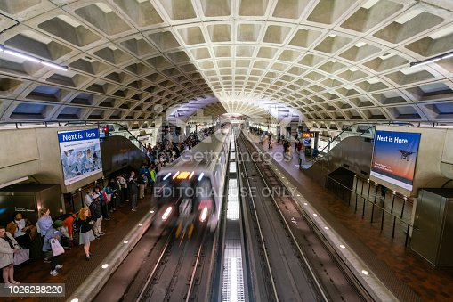 Washington DC, USA - May 18, 2018: Commuters waiting for train at a Metro station in Washington DC