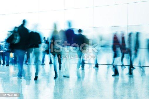 istock Commuters Walking in Corridor, Blurred Motion 157563101