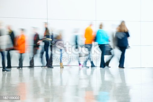 istock Commuters Walking in Corridor, Blurred Motion 182159002