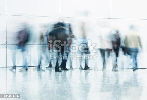 istock Commuters Walking in Corridor, Blurred Motion 182382915