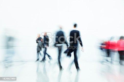 istock Commuters Walking in Corridor, Blurred Motion 182662965