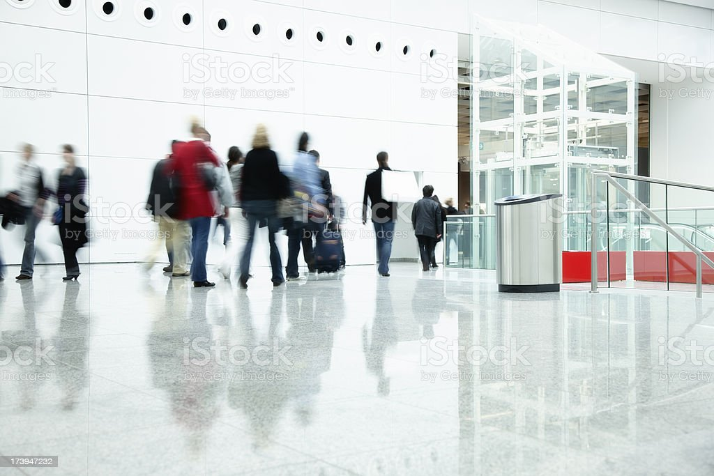 Commuters Walking in Modern Corridor, Blurred Motion stock photo