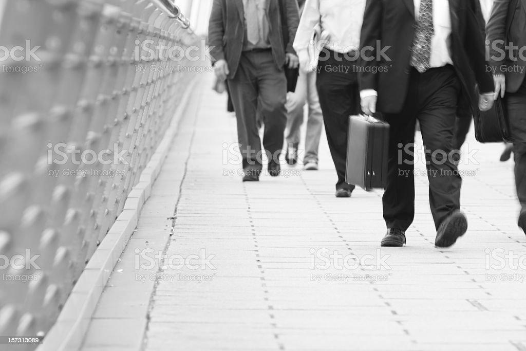 Commuters walking on the sidewalk royalty-free stock photo
