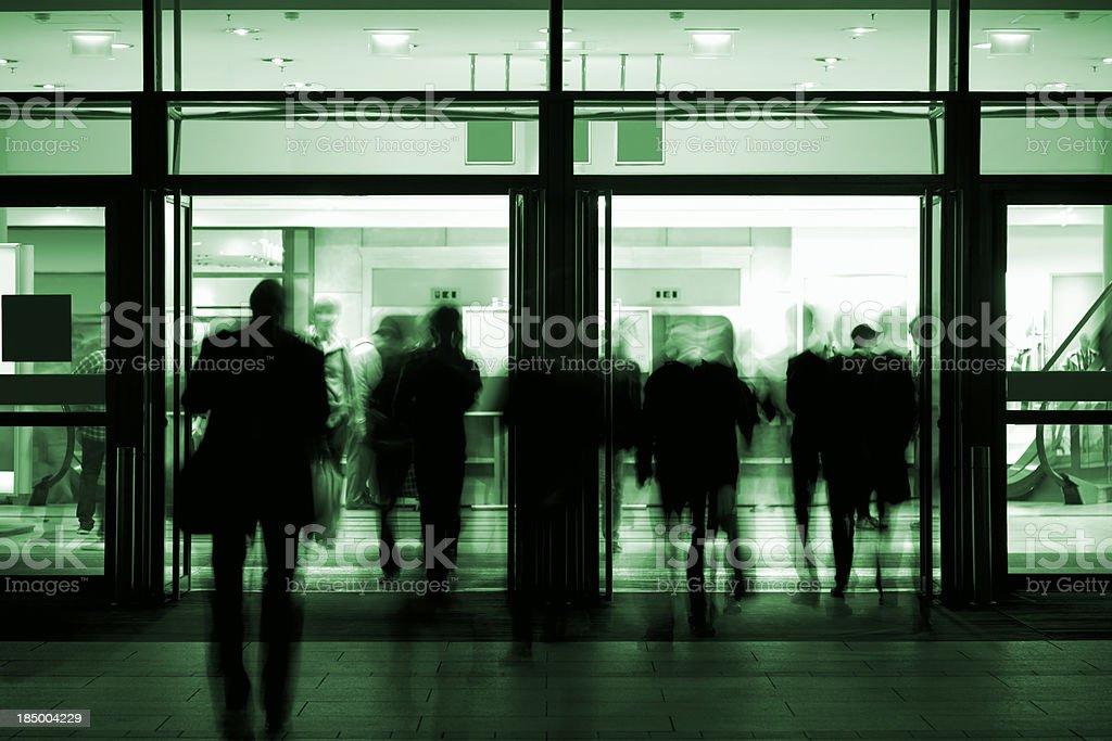 Commuters Walking Through Doorway royalty-free stock photo