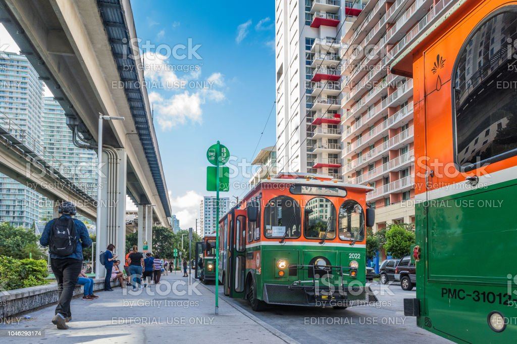 Commuting in Miami Miami, Florida, USA - September 27, 2018: Crowded commuter Brickell Trolley Bus Station and Miami Metrorail at downtown district. The trolley service, is a free public transportation used by a lot of people. Streetcar style trolley-replica buses have been implemented in over a dozen cities in Miami-Dade. American Culture Stock Photo