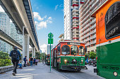 Miami, Florida, USA - September 27, 2018: Crowded commuter Brickell Trolley Bus Station and Miami Metrorail at downtown district. The trolley service, is a free public transportation used by a lot of people. Streetcar style trolley-replica buses have been implemented in over a dozen cities in Miami-Dade.