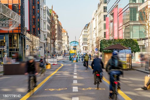 istock Commuting to Work on a Pop-Up Bike Lane in the City Center 1307779142