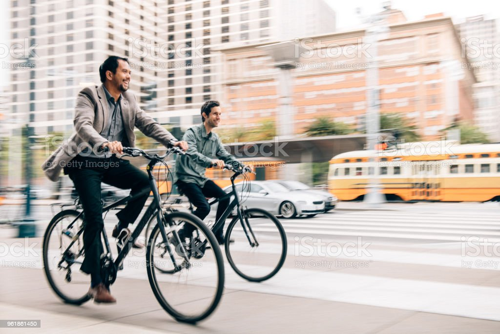 Commuting with work partner by bicycle stock photo