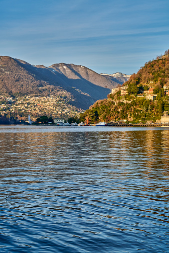 A view of Como Lake on a sunny day of winter. Como. Lombardy. Italy.