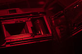 Old compact camera for 35mm film in the darkroom, perfect under red light