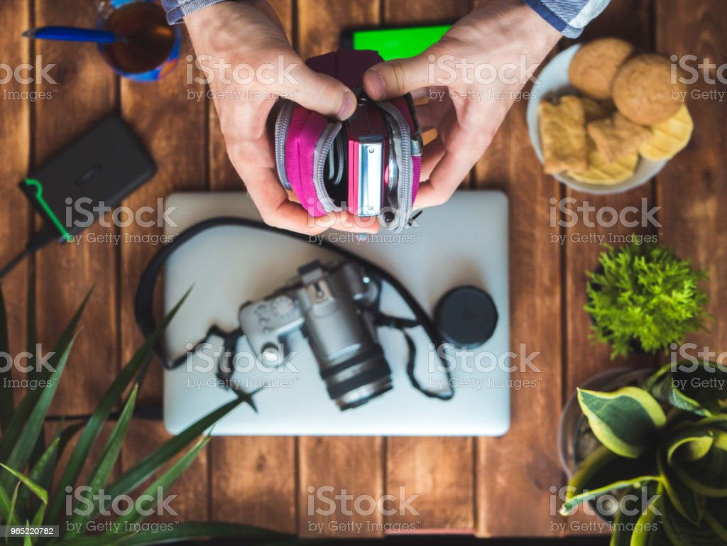 compact camera in protection case in hands royalty-free stock photo