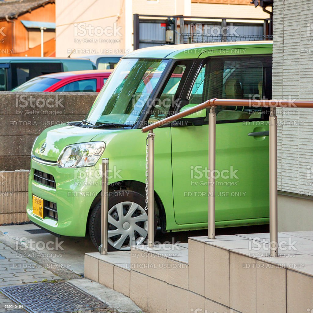 Compact car on small parking space royalty-free stock photo