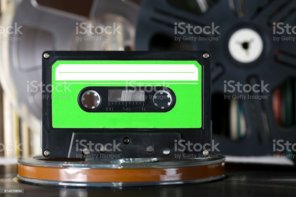 Compact cassette and its white and green label stock photo