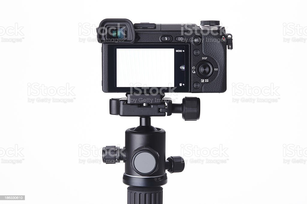 Compact digital camera on mini tripod stock photo