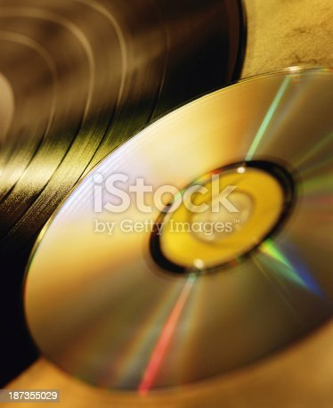 A compact disc and a LP record.