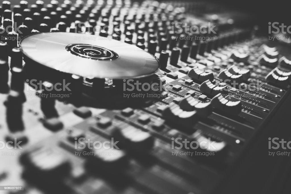 compact disc on sound mixer stock photo