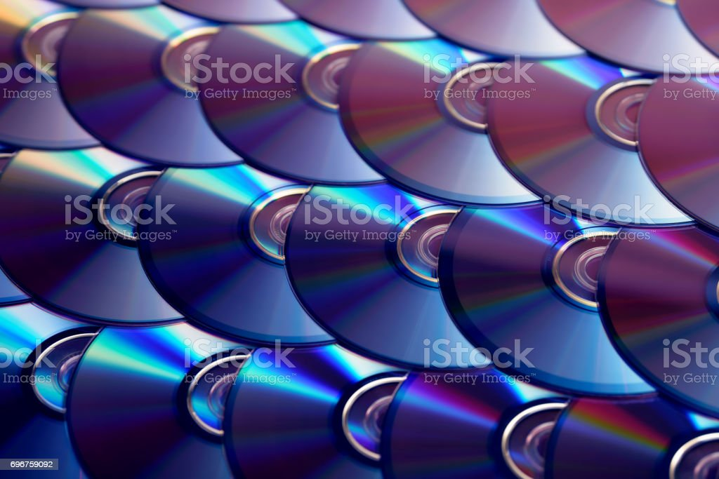 Compact discs background. Several cd dvd blu-ray discs. Optical recordable or rewritable digital data storage. stock photo