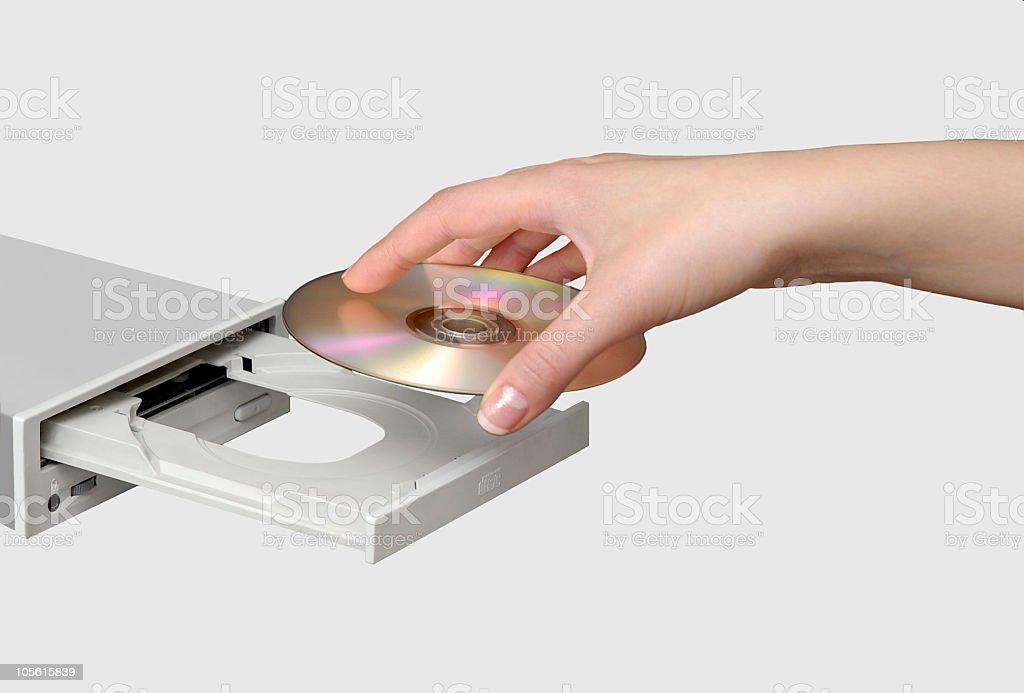 Compact disk drive and hand inserting CD royalty-free stock photo