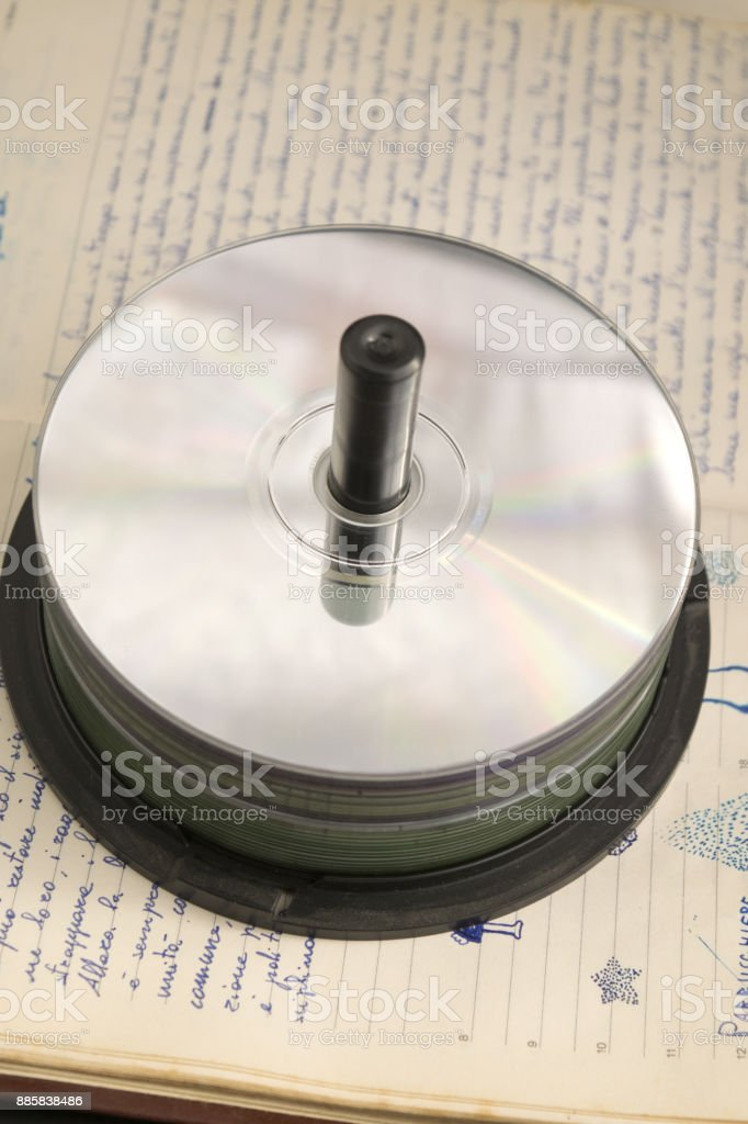 compact disks and old manuscript stock photo
