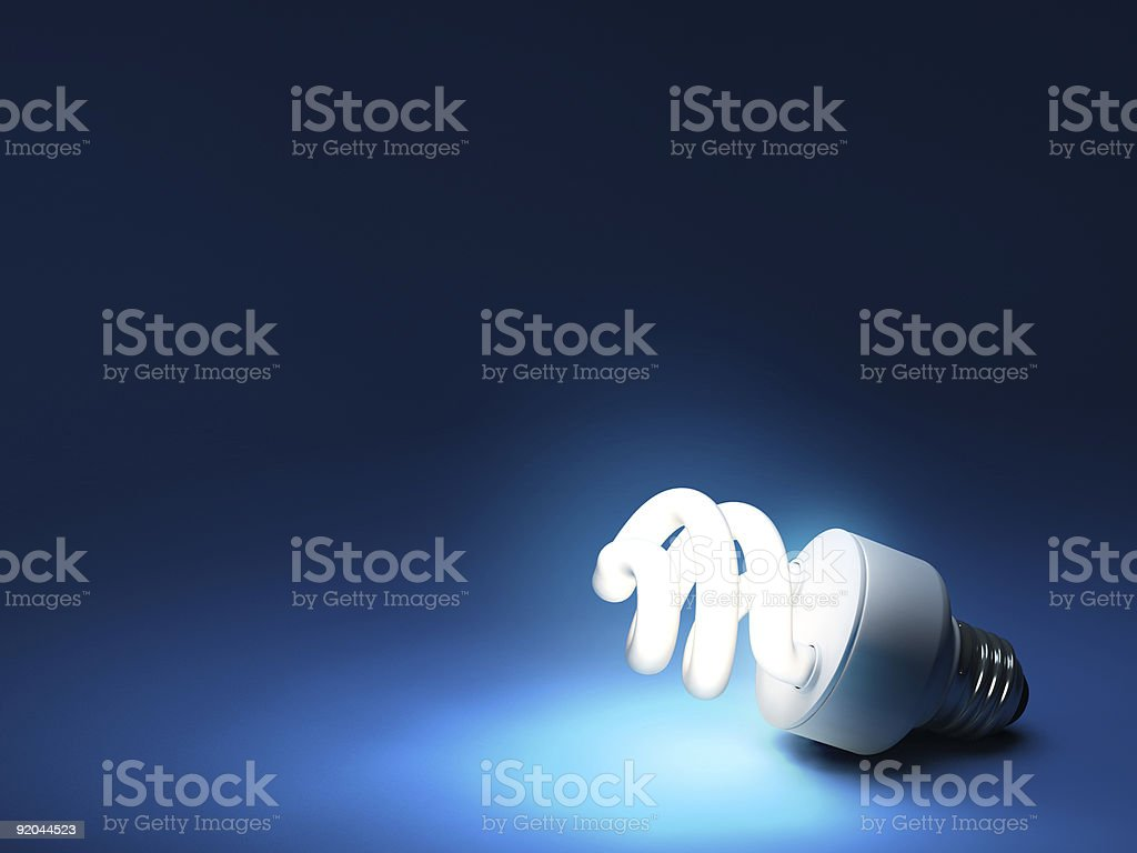 Compact Fluorescent Bulb - Resting on ground stock photo