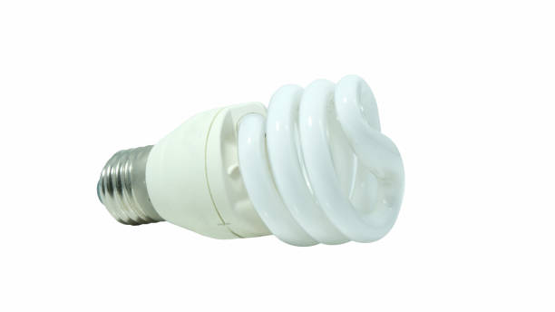 A compact fluorescent lamp (CFL), also called compact fluorescent light, energy-saving light bulb isolated on white background. A compact fluorescent lamp (CFL), also called compact fluorescent light, energy-saving light bulb isolated on white background. canadian football league stock pictures, royalty-free photos & images
