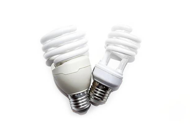 Compact fluorescent lamps isolate on white background Compact fluorescent lamps isolate on white background canadian football league stock pictures, royalty-free photos & images