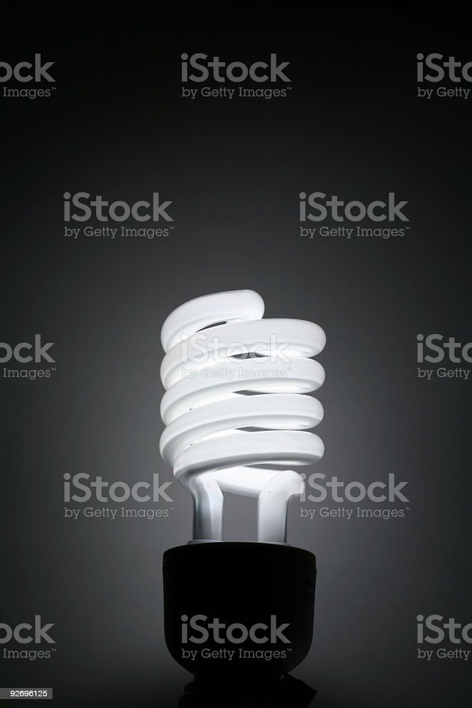 Compact fluorescent lightbulb stock photo