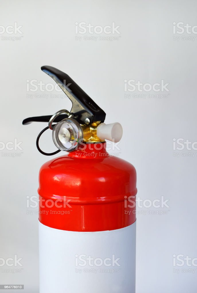 Compact red fire extinguisher for auto or home on white background. For fire emergencies. royalty-free stock photo