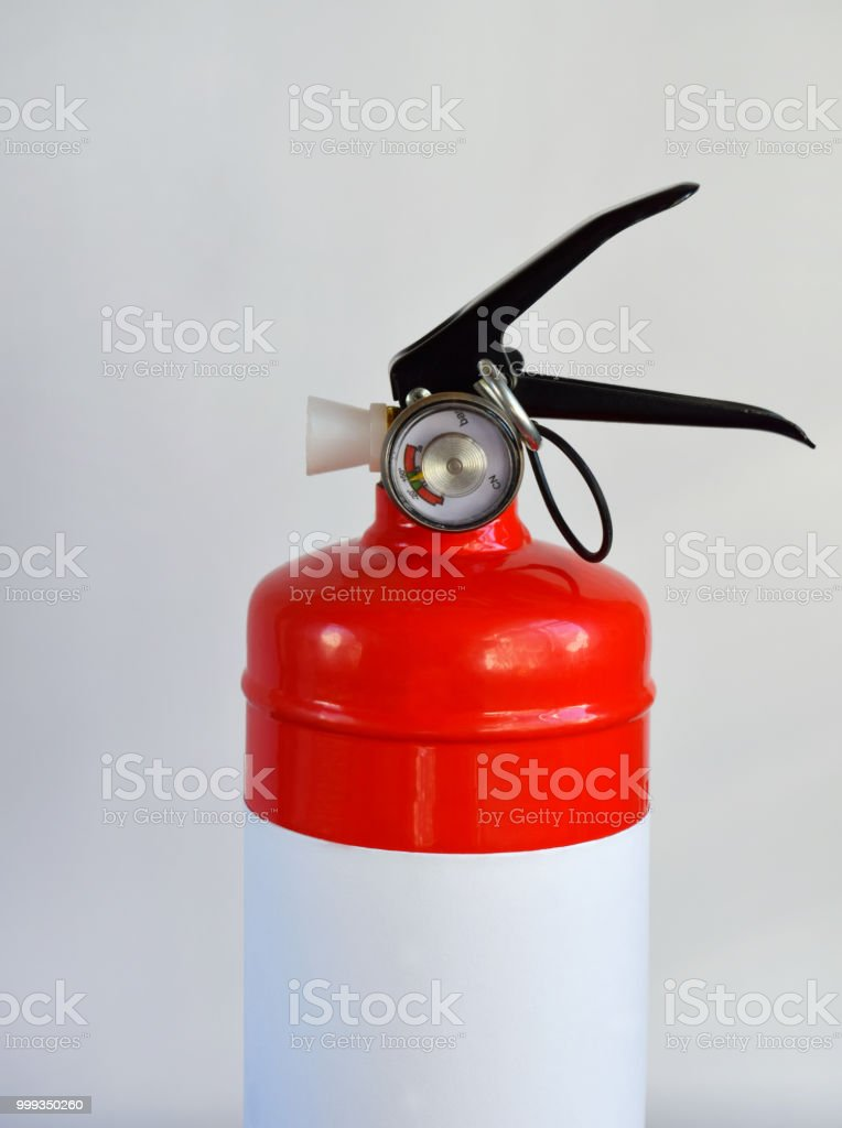 Compact red fire extinguisher for auto or home on white background....