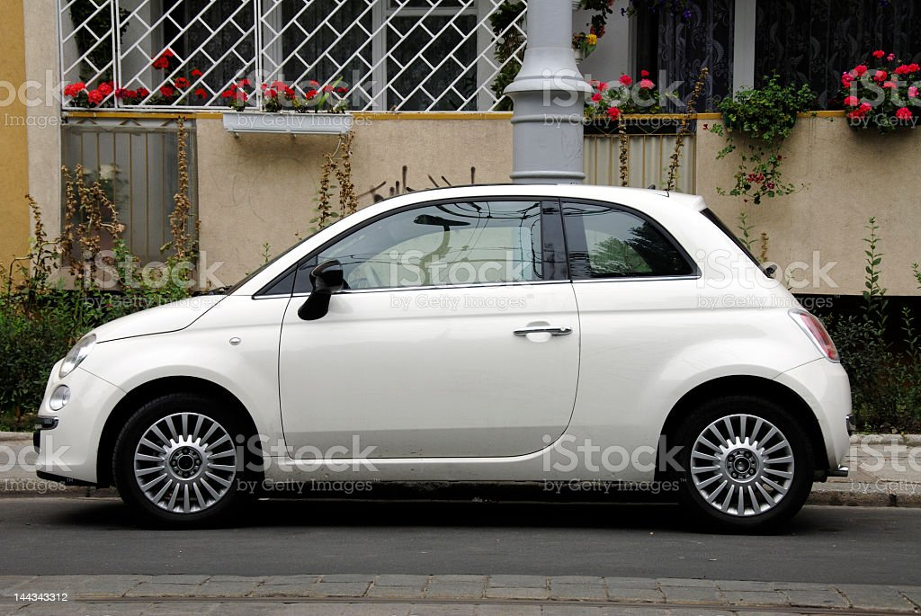 Compact white car parked on the street stock photo