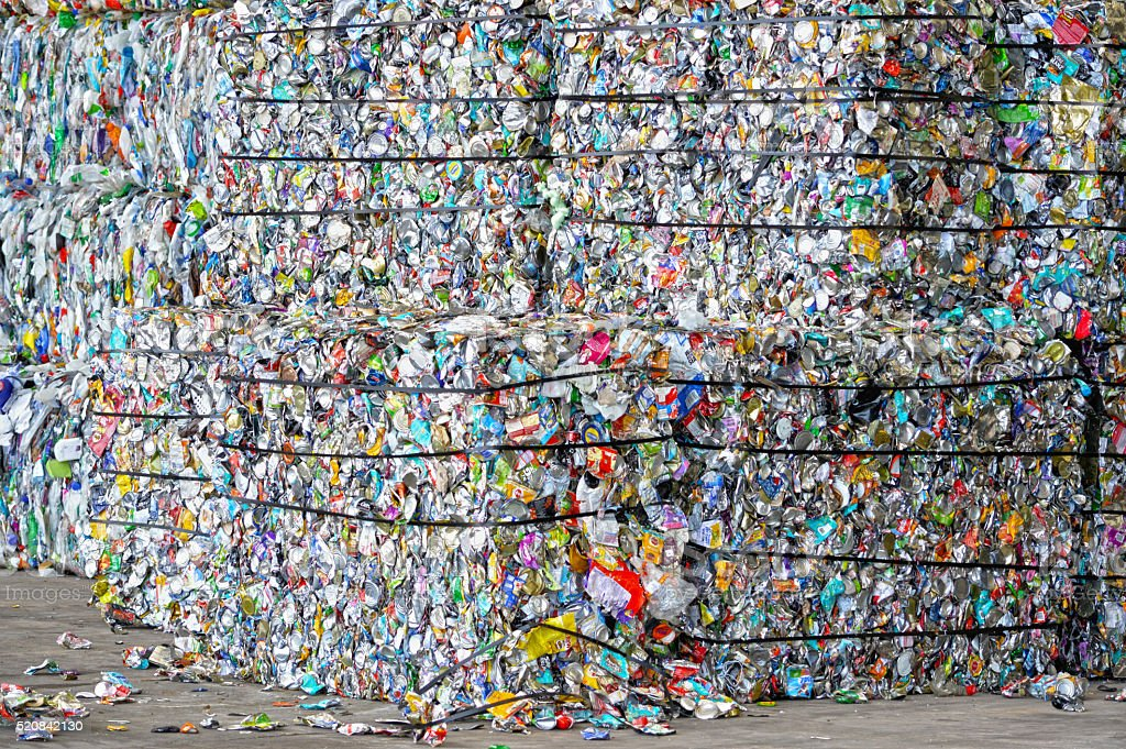 Compacted Cans ready for recycling stock photo